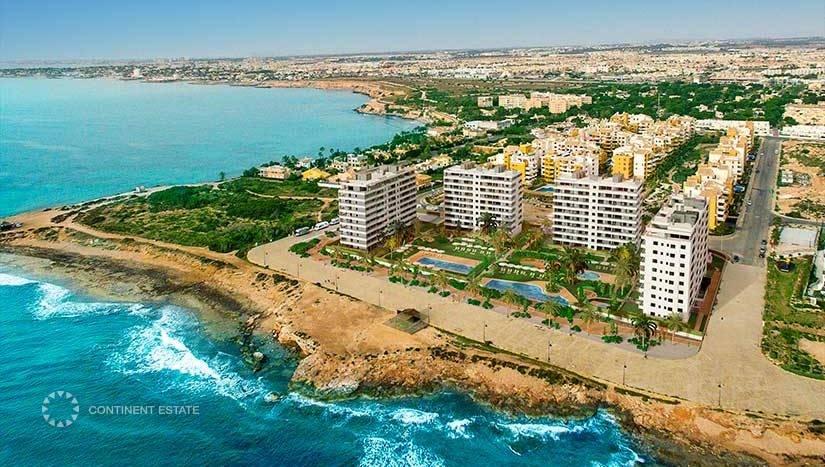 Апартаменты в новостройке на первой линии от моря на продажу в Испании (Побережье Коста Бланка, Ориуэла Коста — Punta Prima)